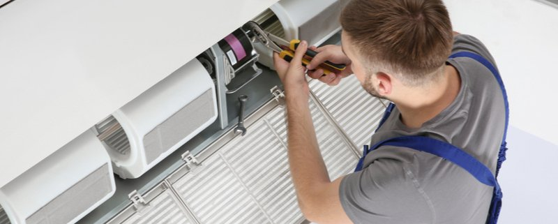 Technician working on an air conditioning system